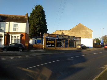 Former car tyre showroom and land sells in Rugeley